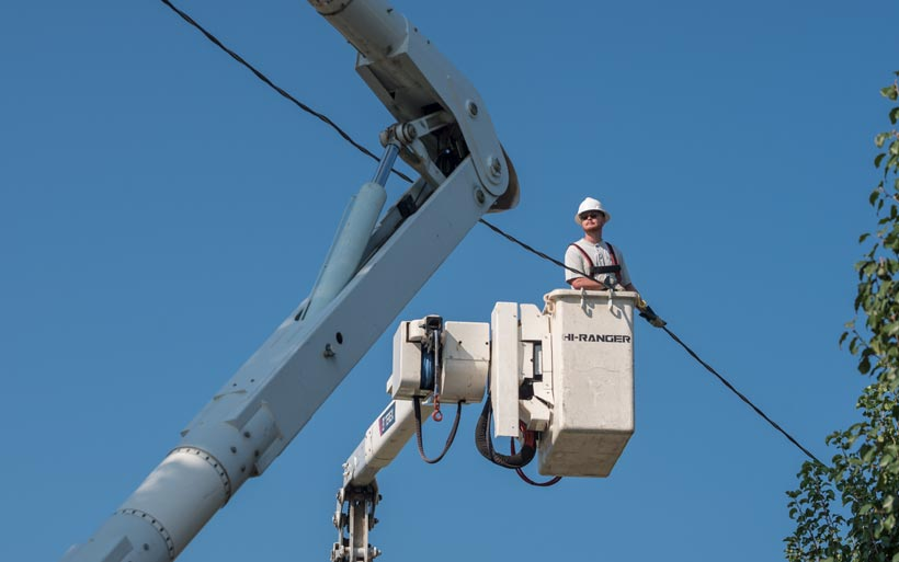 Barbourville Utility Commission electric lineman in lift bucket.
